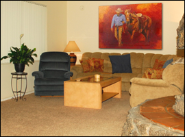 A large living room with fireplace at the Northeast Phoenix Sober House